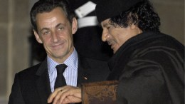 File Photo: French President Nicolas Sarkozy (L) greets Libyan leader Muammar Gaddafi (R) as he arrives for dinner at Palais Elysee, Paris, France. EPA, MAYA VIDON