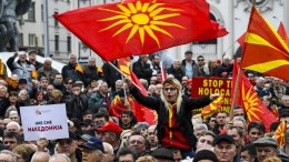 File Photo: Thousands of Fyromians citizens wave the national flags and shout slogans protesting against the change of the constitutional name of FYROM at the main square in Skopje. EPA, GEORGI LICOVSKI