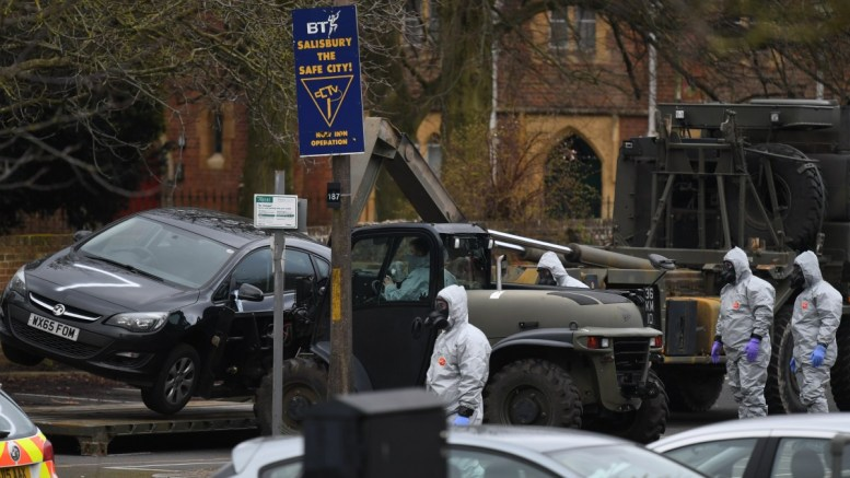 File Photo: Military in protective clothing remove vehicles from a car park in Salisbury, Britain. Russian ex-spy Sergei Skripal and his daughter were attacked with a nerve agent on 04 March 2018. EPA, NEIL HALL