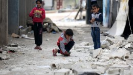 Children play at the recently captured city of Afrin, Syria, 19 March 2018. EPA, AREF TAMMAWI