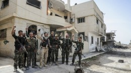 FILE PHOTO.  A handout photo made available by Syrian Arab news agency SANA shows Syrian army soldiers in Al-Nashabieh town in Eastern Ghouta Damascus. EPA, SANA HANDOUT HANDOUT EDITORIAL USE ONLY, NO SALES