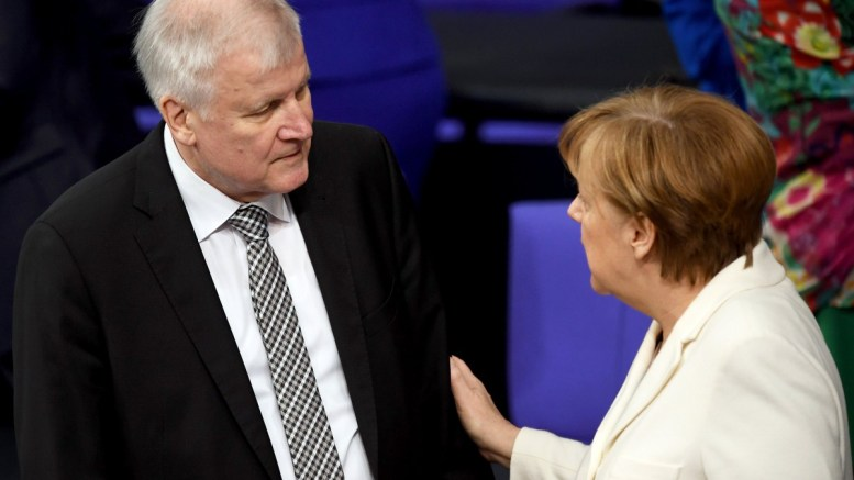 File Photo: German Chancellor Angela Merkel (R) talks with Minister of Interior, Construction and Homeland, Horst Seehofer (L) before he is sworn in by the President of the German Parliament EPA, CLEMENS BILAN