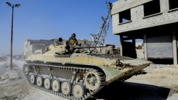 File Photo: Syrian Arab Army soldiers in an armored vehicle. 07 March 2018. . EPA, SANA HANDOUT HANDOUT EDITORIAL USE ONLY, NO SALES