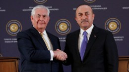 File photo: US Secretary of State Rex Tillerson (L) shake hands with Turkish Foreign Minister Mevlut Cavusoglu (R) after their press conference in Ankara, Turkey. EPA, TUMAY BERKIN