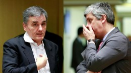 File Photo:Greek Finance Minister Euclid Tsakalotos (L) and President of the Eurogroup, Portuguese Finance Minister Mario Centeno speak at the start of a Eurogroup Finance Ministers' meeting, at the EU Council, in Brussels, Belgium. EPA, OLIVIER HOSLET