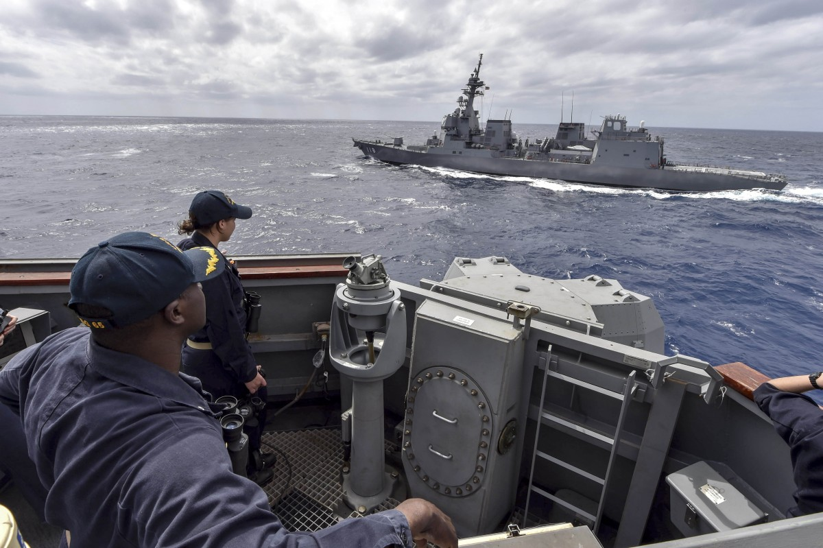 Cmdr. Leroy Mitchell, commanding officer of the Arleigh Burke-class guided-missile destroyer USS Benfold (DDG 65), and Ensign Nancy Smith, from Asheville, North Carolina observe as Japanese Maritime Self-defense Force Akizuki-class destroyer JS Fuyuzuki (DD-118) sails alongside during a close quarters maneuvering exercise. USS Benfold is forward-deployed to the U.S. 7th Fleet area of operations in support of security and stability in the Indo-Pacific region, PHOTO BY U.S. DEPARTMENT OF DEFENSE