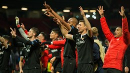 Sevilla players celebrate after winning the UEFA Champions League Round of 16 second leg soccer match between Manchester United and Sevilla FC held at Old Trafford, Manchester, Britain, 13 March 2018. EPA,PETER POWELL