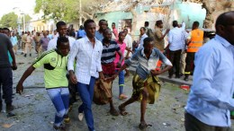 Local resident carry away a wounded person after a car bomb exploded in downtown Mogadishu, Somalia, 23 March 2018. Media reports state that at least six people were killed and numerous others injured when a massive car bomb went off outside of a hotel in the country's capital. The responsibility for the attack was claimed by the al-Kaida linked local militant group Al-Shabaab, the media reports say. EPA.SAID YSUSF WARSAME