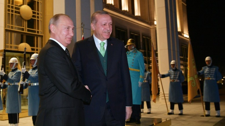 File Photo: Russian President Vladimir Putin (L) shakes hands with Turkish President Recep Tayyip Erdogan (R) in Ankara, Turkey. EPA, ALEXEI DRUZHININ, SPUTNIK, KREMLIN POOL