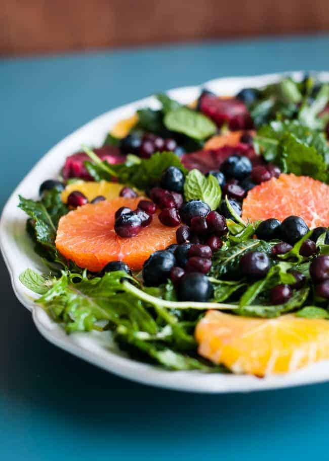Baby Kale Salad with Oranges, Blueberries and Pomegranate   HelloNatural.co
