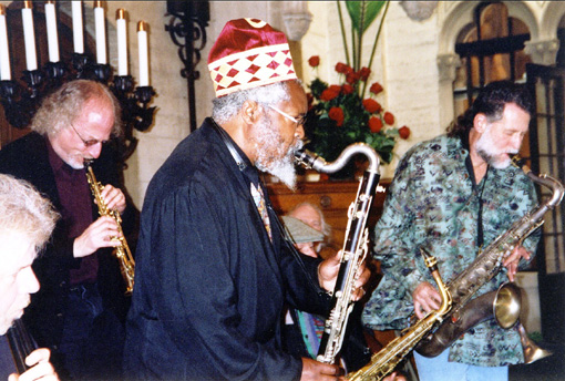 Players playing at Ben's Memorial, Chapel of the Chimes, Oakland: Doug Carroll, Larry Ochs, Oluyemi Thomas, John Gruntfest (seated, alto in hand), Henry Kuntz | Photo: Eleanor Lindgren | 2002
