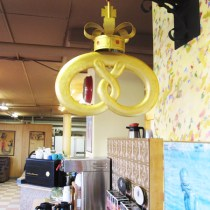 Catch the homey artwork and decor like this amazing giant gold kringle