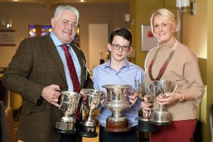 James and Bradley Graham and Lindsey McCallister, from Richmount Herefords, Portadown, with their trophies at the NI Hereford Breeders' Association dinner, Enniskillen. Picture: Cliff Donaldson
