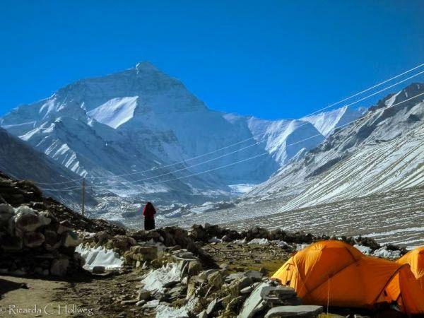 Nun in front of Mount Everest