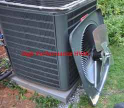Delay Timers and the Air Conditioner Condenser - Unit with the top off - condenser fan motor