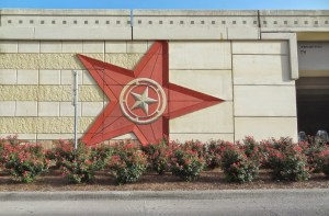Texas Freeway road art - Lone Star State on abutment wall with landscaping June 2014 I-10 pic