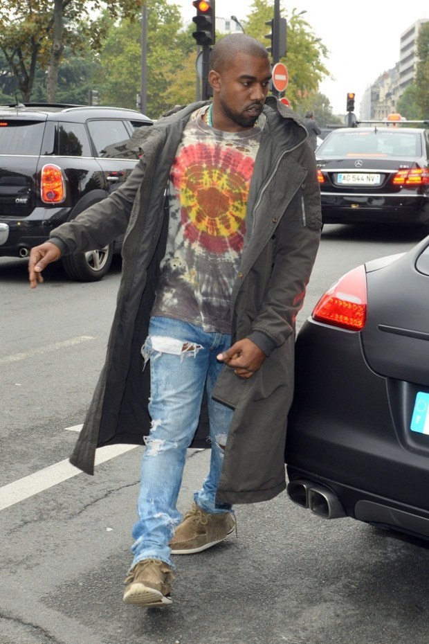 Kanye West seen parking his Porsche in Paris