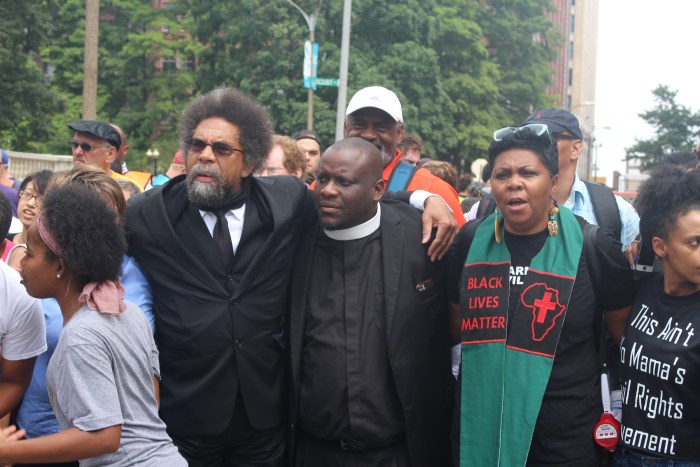 Faith leaders march to Department of Justice in St Louis to win Justice for Mike Brown... Dr Cornel West, Pastor Mike McBride and Reverend Toni Blackman
