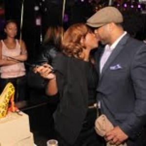 Mona and husband Shawn kissing