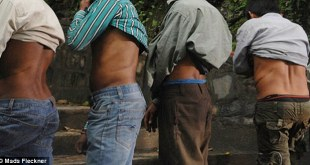 2A66796900000578-3155817-Showing_off_their_scars_the_men_of_Kidney_Village_in_Hokse_Nepal-a-22_1436515570816