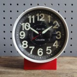 Red Columbia alarm clock