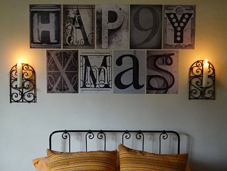 sheets of font characters from the 1Wall Creative Collage set spelling out Happy Xmas