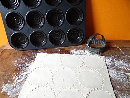 Making puff pastry cases for Portuguese custard tarts