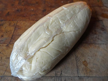 rolling hot water pastry in cling film before putting it in the fridge