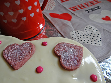 detail of frosted & decorated red velvet cake with cup of tea | H is for Home