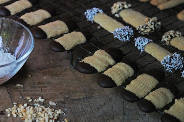 Viennese fingers being dipped in chocolate, chopped nuts and dessicated coconut | H is for Home