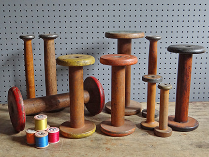 collection of vintage bobbins and spools of thread
