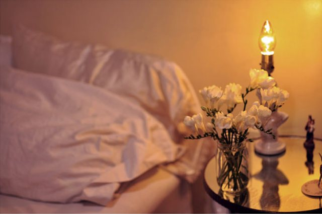 Electric candlelight at a bedside