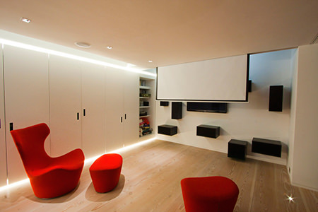 minimalist red & white home cinema room