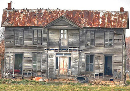 delapidated wooden house