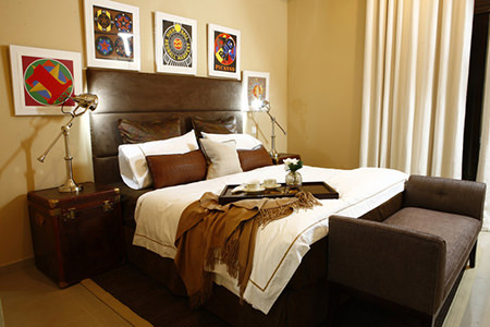 Bedroom in the Emirates Crown decorated in black coffee and other shades of brown
