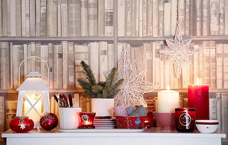 Sideboard with red, green and white Christmas decorations