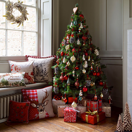 Christmas decorated room in red and green by Marks & Spencer