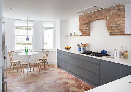 terracotta feature wall and floor in a kitchen