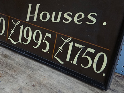 detail of vintage 'Visit Unfurnished Houses' sign