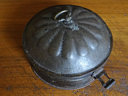 Antique metal spice tin
