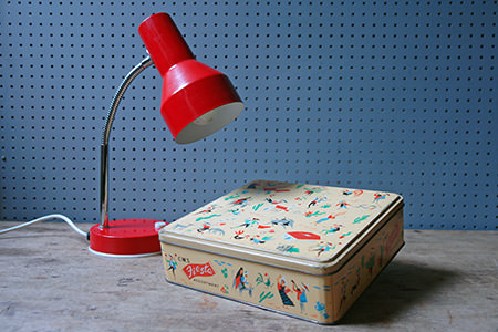 Red vintage goose neck desk lamp and vintage Fiesta biscuit tin