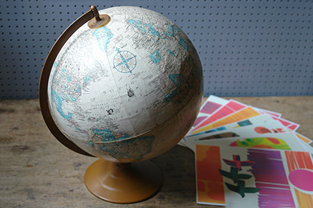 Large vintage desk globe with set of vintage Royal Viking Star cruise menus