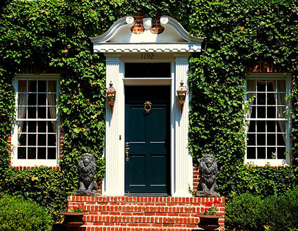 ivy clad house with black front door