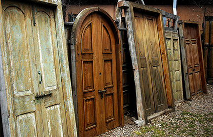 row of different antique wooden doors