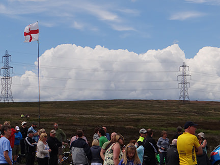 Pylons and a St George's flag in Cragg Vale in Cragg Vale
