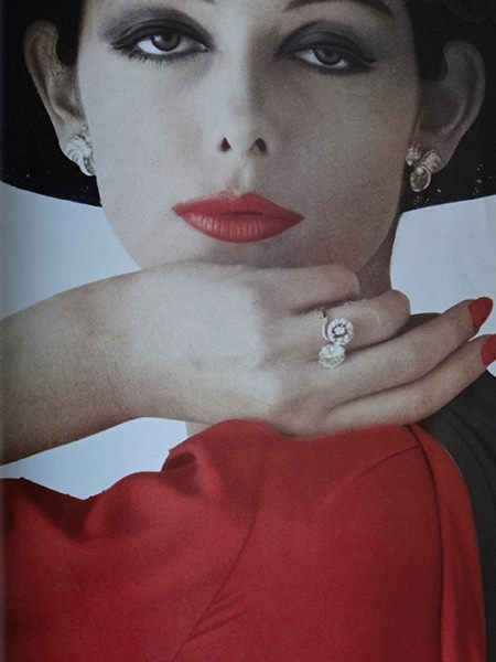 Model with red top and lips and dusky eye make up in Vogue Magazine, February 1962