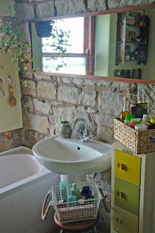 Corner of our bathroom in shades of green, yellow and naturals | H is for Home