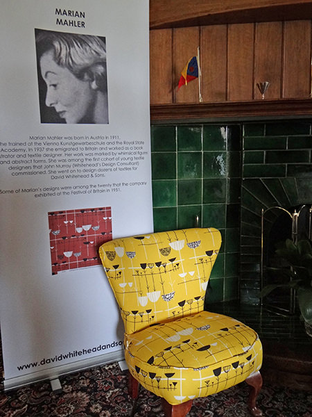 Marian Mahler display including stool covered in relaunched yellow fabric from her original design