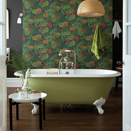 Bathroom decorated with Little Greene Reverie Jungle wallpaper and army green roll top bath