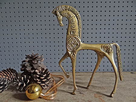 Vintage brass horse figure with pine cones and Christmas bauble